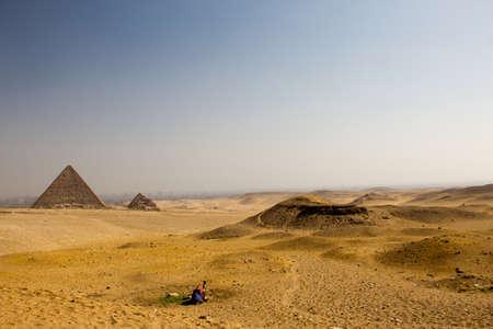 Camel and The Pyramid Stock Photo