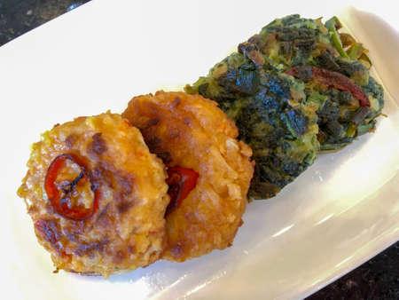 Closeup Korean pancake in side dish portion, kimchi pancake and spinach pancake. Bite-size