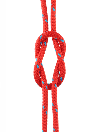 knotted: Reef Knot Tied in Red Rope Isolated on White