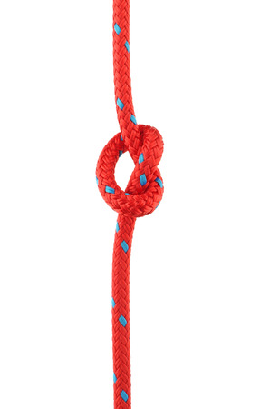 knotted: Knot Tied in Red Rope Isolated on White