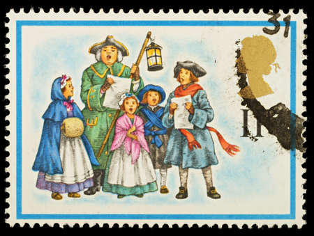 carol: UNITED KINGDOM - CIRCA 1978  A British Used Christmas Postage Stamp showing Carol Singers , circa 1978 Editorial