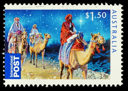camel post: AUSTRALIA - CIRCA 2011: An Australian Used Christmas Postage Stamp showing the Three Kings riding on Camels, circa 2011 Editorial