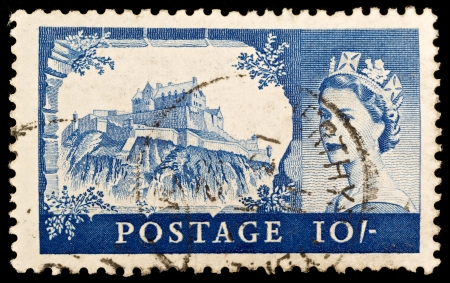 shilling: BRITAIN - CIRCA 1967: An old British ten shilling stamp showing Edinburgh Castle and portrait of Queen Elizabeth II, circa 1967