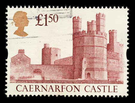 stamp collecting: UNITED KINGDOM - CIRCA 1992: A British £1.50 Used Postage Stamp showing Caernarvon Castle , circa 1992  Editorial