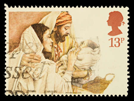 jesus mary joseph: UNITED KINGDOM - CIRCA 1984: A British Used Christmas Postage Stamp showing Mary, Joseph and Jesus, circa 1984 Editorial