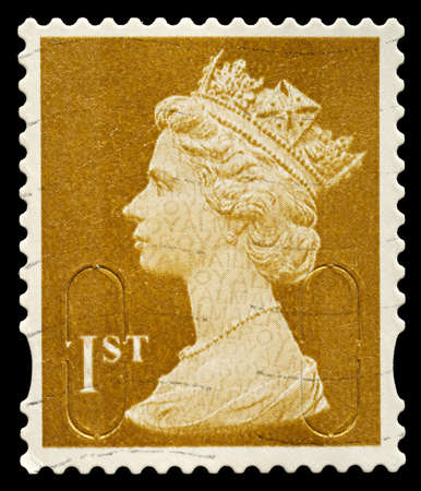 stamp collecting: UNITED KINGDOM - CIRCA 2010: An English Used First Class Postage Stamp showing Portrait of Queen Elizabeth 2nd, circa 2010