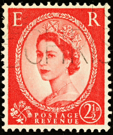 UNITED KINGDOM - 1952 - 1965: An English Two and a Half Pence Red Used Postage Stamp showing Portrait of Queen Elizabeth 2nd, 1952 - 1965