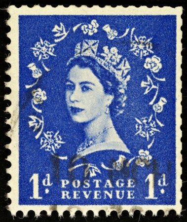 elizabeth: UNITED KINGDOM - 1952 - 1965: An English One Pence Blue Used Postage Stamp showing Portrait of Queen Elizabeth 2nd, 1952 - 1965