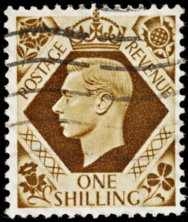shilling: UNITED KINGDOM - 1937 -1947: An English One Shilling Brown Used Postage Stamp showing Portrait of King George VI, 1937 -1947  Editorial