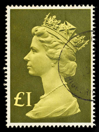 elizabeth: UNITED KINGDOM - CIRCA 1977 to 1987: An English One Pound Used Postage Stamp showing Portrait of Queen Elizabeth 2nd, circa 1977 to 1987  Editorial