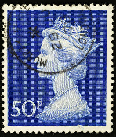 elizabeth: UNITED KINGDOM - 1970 - 1972: An English Fifty Pence Used Postage Stamp showing Portrait of Queen Elizabeth 2nd, 1970 - 1972