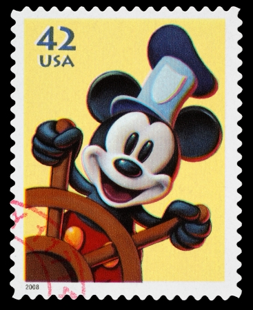United States - CIRCA 2008  A Used Postage Stamp printed in the United States, showing Mickey Mouse from the Disney film Steamboat Willie, circa 2008 Reklamní fotografie - 22688195