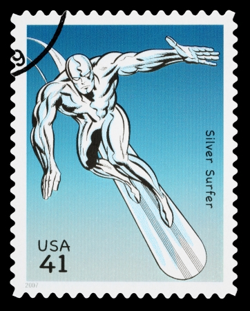 four person: UNITED STATES - CIRCA 2007: A Used Postage Stamp printed in the USA showing the Superhero The Silver Surfer, circa 2007