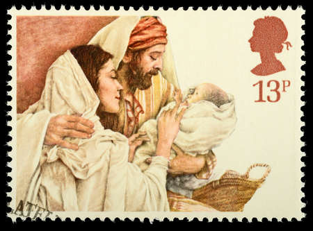 postage stamp: UNITED KINGDOM - CIRCA 1984: A British Used Christmas Postage Stamp showing Mary, Joseph and Baby Jesus, circa 1984