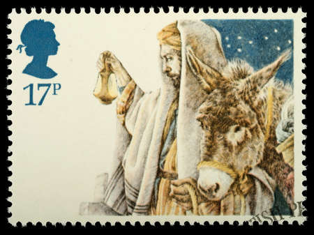bible christmas: UNITED KINGDOM - CIRCA 1984: A British Used Christmas Postage Stamp showing the Arrival in Bethlehem, circa 1984