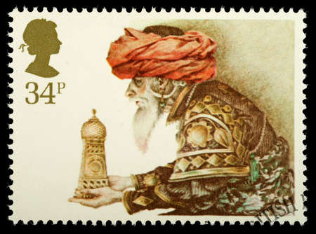 UNITED KINGDOM - CIRCA 1984: A British Used Christmas Postage Stamp showing Wise Man and Gift, circa 1984