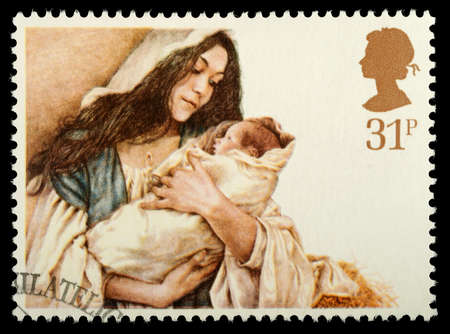 christmas religious: UNITED KINGDOM - CIRCA 1984: A British Used Christmas Postage Stamp showing Virgin Mary and Baby Jesus, circa 1984