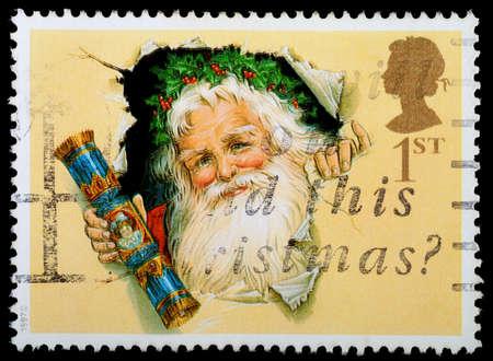 UNITED KINGDOM - CIRCA 1997  A British Used Christmas Postage Stamp showing Father Christmas and Christmas Cracker, circa 1997