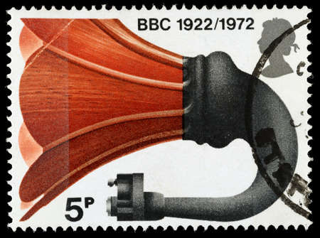 UNITED KINGDOM - CIRCA 1972: A used postage stamp printed in Britain celebrating the 50th Anniversary of the BBC showing a Horn Loadspeaker, circa 1972