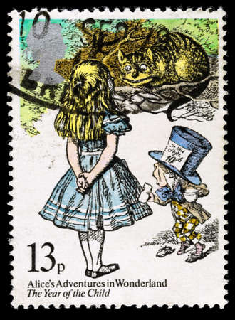 lewis carroll: UNITED KINGDOM - CIRCA 1979: A used postage stamp printed in Britain showing Alice in Wonderland by Lewis carroll, circa 1979 Editorial