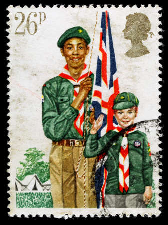 scout: UNITED KINGDOM - CIRCA 1982: A used postage stamp printed in Britain celebrating Youth Organistaions showing theBoy Scout Movement, circa 1982 Editorial
