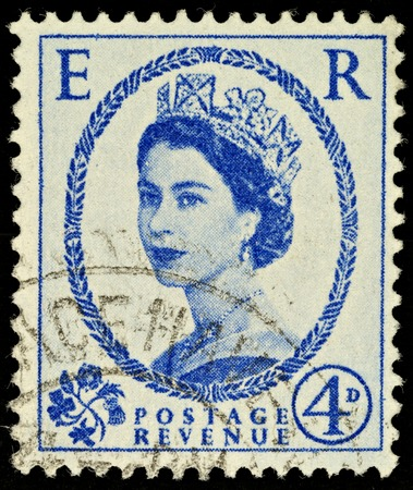 bluer: UNITED KINGDOM - 1952 - 1965  An English Four Pence Bluer Used Postage Stamp showing Portrait of Queen Elizabeth 2nd, 1952 - 1965