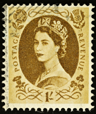 UNITED KINGDOM - 1952 - 1965  An English One Shilling Brown Used Postage Stamp showing Portrait of Queen Elizabeth 2nd, 1952 - 1965