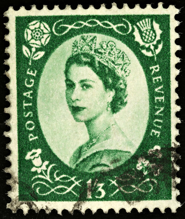 shilling: UNITED KINGDOM - 1952 - 1965  An English One Shilling Brown Used Postage Stamp showing Portrait of Queen Elizabeth 2nd, 1952 - 1965