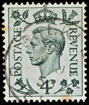 vi: UNITED KINGDOM - 1937 - 1947  An English Four Penny Green Used Postage Stamp showing Portrait of King George VI, 1937 -1947