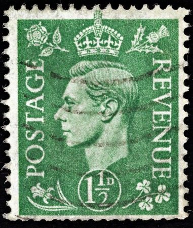 vi: UNITED KINGDOM - CIRCA 1950 to 1952  An English One and a Half Pence Green Used Postage Stamp showing Portrait of King George VI, circa 1950 to 1952