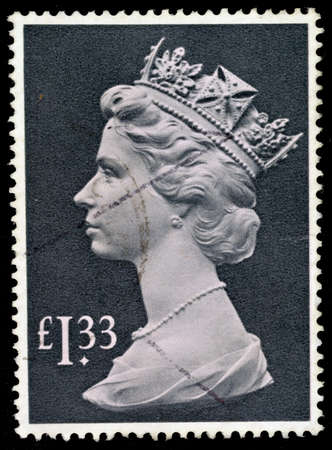 UNITED KINGDOM - CIRCA 1977 to 1984  An English Used Postage Stamp showing Portrait of Queen Elizabeth 2nd, circa 1977 to 1984