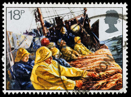 UNITED KINGDOM - CIRCA 1981: A used postage stamp printed in Britain celebrating the Fishing Industry showing aTrawl Net being Hauled, circa 1981