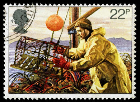 lobster pots: UNITED KINGDOM - CIRCA 1981: A used postage stamp printed in Britain celebrating the Fishing Industry showing Lobster Potting, circa 1981