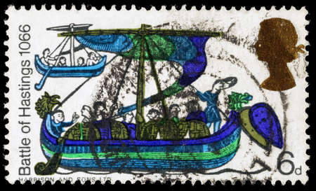 hastings: UNITED KINGDOM - CIRCA 1966: A used postage stamp printed in Britain celebrating the 900th Anniversary of the Battle of Hastings, showing a scene from the Bayeaux Tapestry, circa 1966