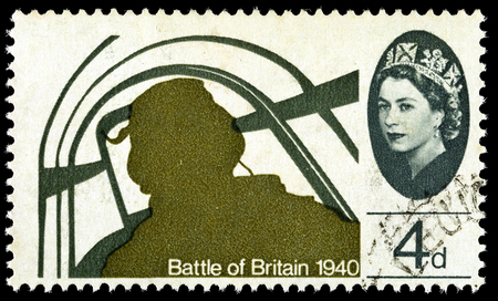 UNITED KINGDOM - CIRCA 1965: A used postage stamp printed in Britain celebrating the 25th Anniversary of the Battle of Britain showing a Pilot in  Hawker Hurricane Fighter, circa 1965