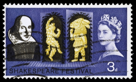 william shakespeare: UNITED KINGDOM - CIRCA 1964: A used postage stamp printed in Britain shwoing William Shakespeare and scene from the Play A Midsummer Nights Deam, circa 1964