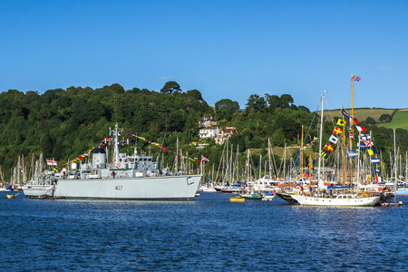 flagship: DARTMOUTH, UNITED KINGDOM - AUGUST 31: Royal Navy Vessel M37 HMS Chiddingfold acting as Flagship for the Dartmouth Royal Regatta on August 31 2013 at Dartmouth, UK