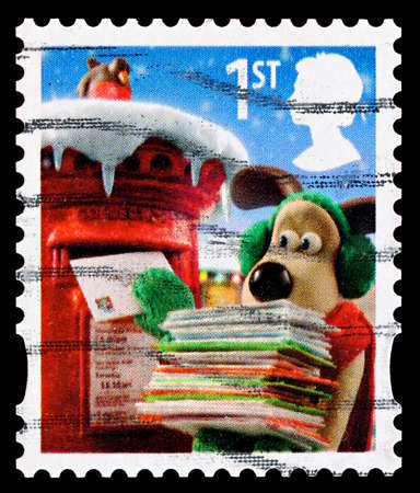 UNITED KINGDOM - CIRCA 2010: A British Used Christmas Postage Stamp showing Gromit posting Christmas Cards, circa 2010