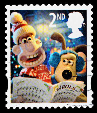 UNITED KINGDOM - CIRCA 2010: A British Used Christmas Postage Stamp showing Wallace and Gromit Carol Singing, circa 2010