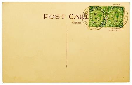 GRAN BRETAGNA - 1934: Bianco antico posteriore di una cartolina con due francobolli britannico annullata Ioslated su sfondo bianco 1967