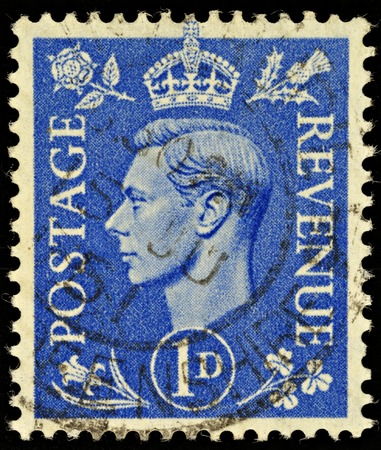 stamp collecting: UNITED KINGDOM - CIRCA 1950 to 1952: An English One Penny Blue Used Postage Stamp showing Portrait of King George VI, circa 1950 to 1952