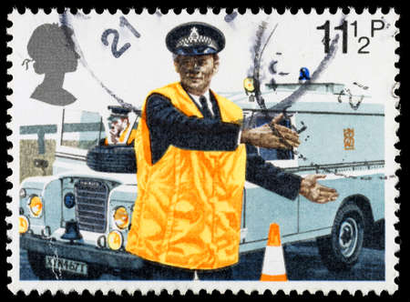 directing: UNITED KINGDOM - CIRCA 1979: A used postage stamp printed in Britain celebrating the 150th Anniversary of the Metropolitan Police showing a Policeman directing Traffic, circa 1979 Editorial