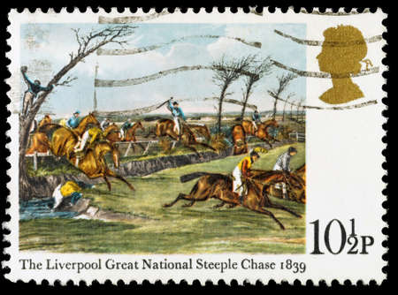 steeplechase: UNITED KINGDOM - CIRCA 1979: A used postage stamp printed in Britain celebrating the Centenary of the Derby Horse Race, showing the 1839 Liverpool Great National Steeplechase, circa 1979 Editorial