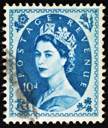 elizabeth: UNITED KINGDOM - 1952 - 1965: An English Ten Pence Blue Used Postage Stamp showing Portrait of Queen Elizabeth 2nd, 1952 - 1965
