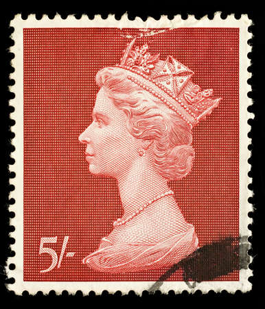 shilling: UNITED KINGDOM - CIRCA 1969: An English Five Shilling Used Postage Stamp showing Portrait of Queen Elizabeth 2nd, circa 1969