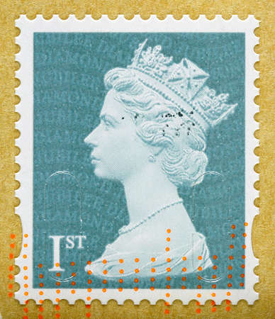 UNITED KINGDOM 2012  A used First Class postage stamp on brown envelope printed in Britain showing Portrait of Queen Elizabeth 2nd, circa 2012