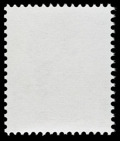 黒の背景に分離された空白の郵便切手 写真素材