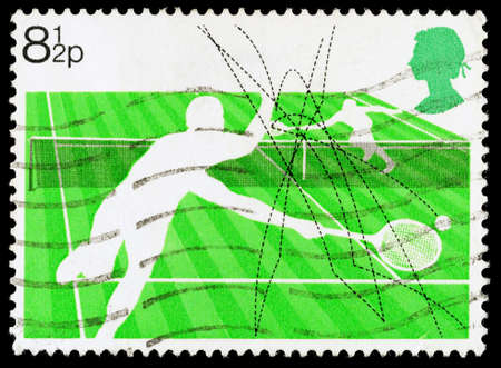 franked: UNITED KINGDOM - CIRCA 1977: A used postage stamp printed in Britain celebrating Racket Sports showing Lawn Tennis, circa 1977