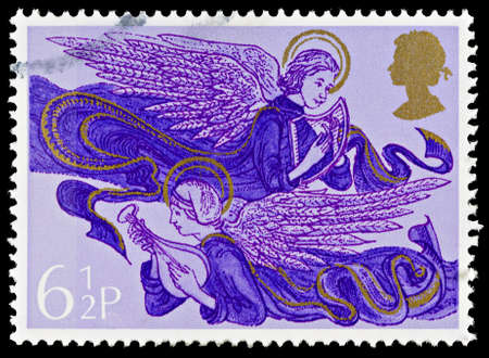 UNITED KINGDOM - CIRCA 1975: A British Used Postage Stamp showing Angels with Harp and Lute, circa 1975