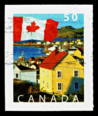 CANADA - CIRCA 2005: Used Canadian Flag Postage Stamp showing the Town of Durrell, South Twillingate Island, Newfoundland, circa 2005 Redakční